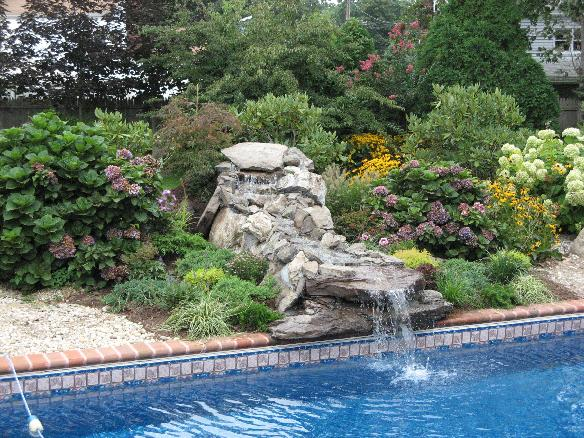 poolside waterfalls with landscaping